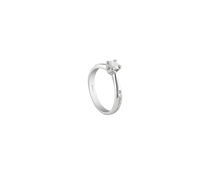 - White gold solitaire ring with diamonds